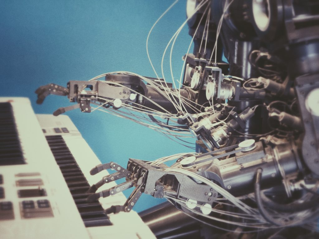 Photo by Franck V. // Robot playing a piano